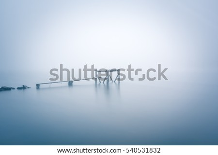 Minimalistic landscape. Fog river walkway. Long exposure shot.  #540531832