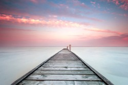 Minimalistic landscape with old jetty.Long exposure shot.