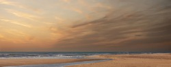 Minimalistic seascape at sunrise with colorful cloudy sky. Beautiful abstract seascape. Panoramic background over the Atlantic ocean