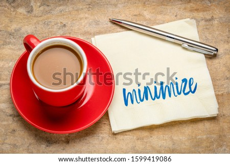 minimize note on napkin with a cup of coffee, simplicity, minimalism and lifestyle concept