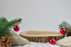 Minimum. Christmas background with a podium for presentation of the product. The pedestal is made of natural wood.