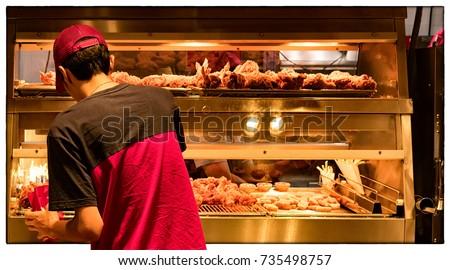 Minimum Wage Employee at a Fast food Restaurant Kitchen
