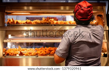 Minimum Wage Employee Works in a Fast Food Kitchen #1379320961