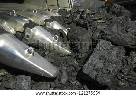 mining, coal loading, black coal, work in a face, the excavator,
