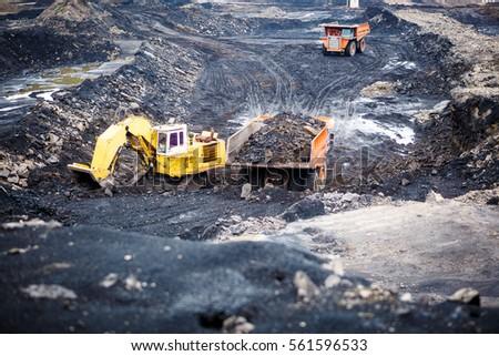 Mining dump trucks working in Lignite coalmine