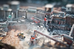 Mining truck working in quarry , tilt-shift effected photo.