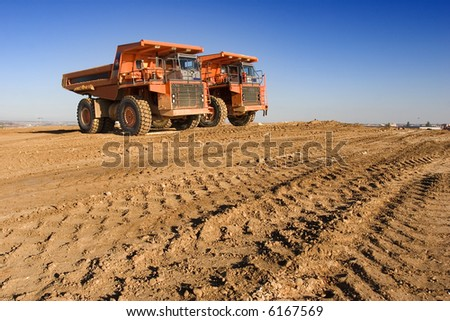 mining trucks at worksite