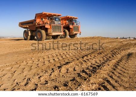 mining trucks at worksite