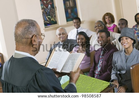 Minister Giving Sermon in Church