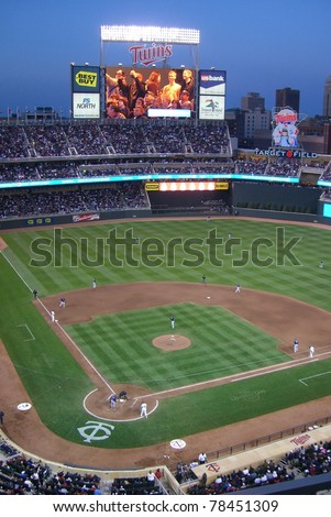 MINNEAPOLIS - APRIL 21: An early season night game at new Target Field on April 21, 2010 in Minneapolis, Minnesota. The Twins home stadium seats 39,504 fans and has 54 private suites. - stock photo