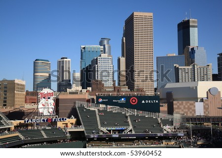 MINNEAPOLIS - APRIL 21: Target Field, the new outdoor stadium of the Minnesota Twins, with skyscrapers towering in the background on April 21, 2010 in Minneapolis, Minnesota. - stock photo