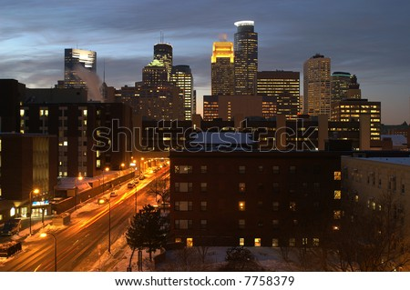 Minneapolis city skyline at dusk with street and moving cars