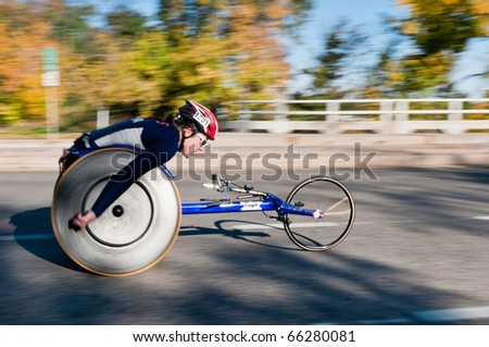 MINNEAPOLIS, MN - OCTOBER 3: Christina Ripp speeds by at Mile 19 and goes on to finish 1st in the Wheelchair Division of the 2010 Medtronic Twin Cities Marathon, October 3, 2010 in Minneapolis, MN