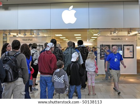 MINNETONKA MN. - APRIL 3:  Customers waiting in line to purchase Apple Ipads on launch day, April 3, 2010, at the Apple Store in Minnetonka, MN.