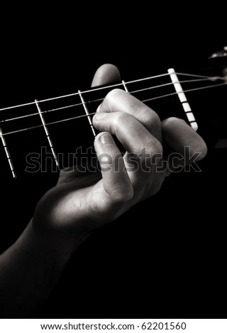 stock photo : Minor seventh chord (Am7) on classical guitar;