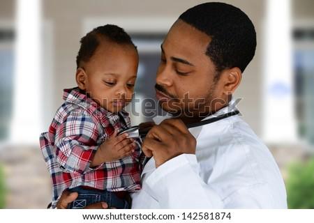 Minority male doctor working in a hospital
