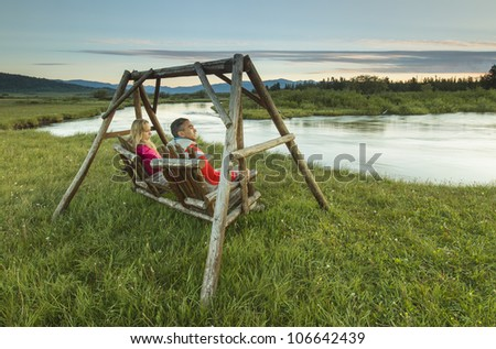 Minority man relaxing and reading near a lake