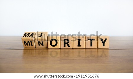 Minority or majority symbol. Turned wooden cubes and changed the word 'minority' to 'majority'. Beautiful wooden table, white background. Minority or majority and business concept. Copy space. Stock photo ©