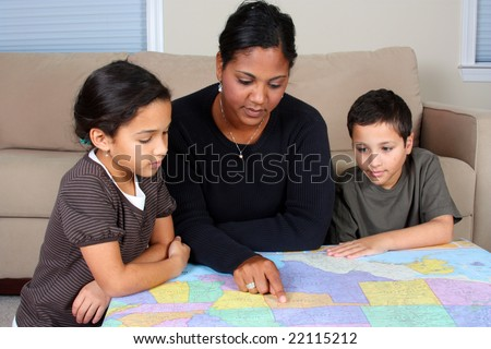 Minority woman and her daughter in living room