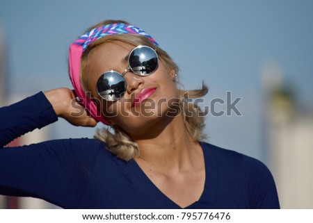 Minority Woman Wearing Sunglasses Wearing Sunglasses #795776476