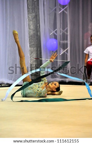 MINSK, BELARUS JULY 14: Arina Sharapa (BLR) competes in the exercise with ribbon during Rhythmic Gymnastics FINAL WCB-MINSK 2012 on July 14, 2012 in Minsk, Belarus.