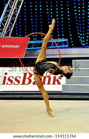 MINSK, BELARUS - JULY 15: Lubov Cherkashina (BLR) competes in the exercise with hoop during Rhythmic Gymnastics FINAL WCB 2012 on July 15, 2012 in Minsk, Belarus.