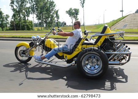 MINSK, BELARUS - JULY 24: Unidentified participant of the biker festival 'Minsk - 2010' on a powerful three-wheeled motorcycle July 24, 2010 in Minsk, Belarus.