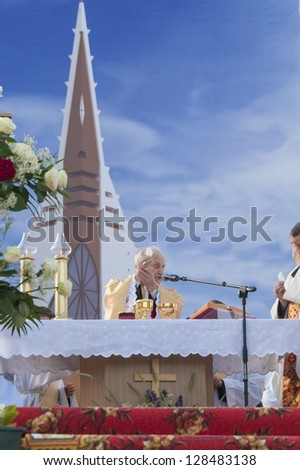 MINSK-BELARUS-JUNE 21:Catholic Bishop praying before breaking of the bread on Minsk Catholic church opening, June 21, 2008 in Minsk, Republic Of Belarus