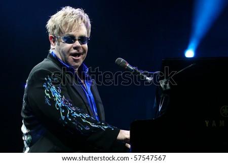 MINSK, BELARUS - JUNE 26: Singer Elton John performs onstage at Minsk Arena June 26, 2010 in Minsk, Belarus - stock photo