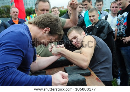 MINSK, BELARUS - Â?Â?JUNE 23: Unidentified sportsmen compete in arm wrestling during NATIONAL OLYMPIC DAY on June 23, 2012 in Minsk, Belarus.