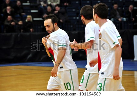 MINSK, BELARUS - MARCH 26: qualification World Cup 2012, Belarus � Portugal: Leader of the Portuguese national team- Ricardinho(left) after goal on March 26, 2012 in Minsk, Belarus