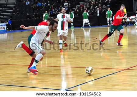 MINSK, BELARUS - MARCH 26: qualification World Cup 2012, Belarus � Portugal: Ricardinho (with ball) rushes to the belarussian gate on March 26, 2012 in Minsk, Belarus