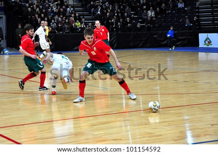 MINSK, BELARUS - MARCH 26: qualification World Cup 2012, Belarus � Portugal: Vladimir Zhigalko (10) selects a ball from an unknown Portuguese footballer on March 26, 2012 in Minsk, Belarus