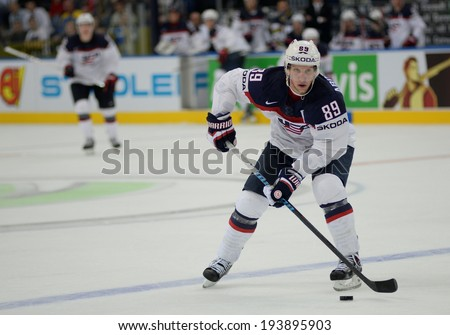 MINSK, BELARUS - MAY 20: ABDELKADER Justin of USA skates with the puck during 2014 IIHF World Ice Hockey Championship match on May 20, 2014 in Minsk, Belarus
