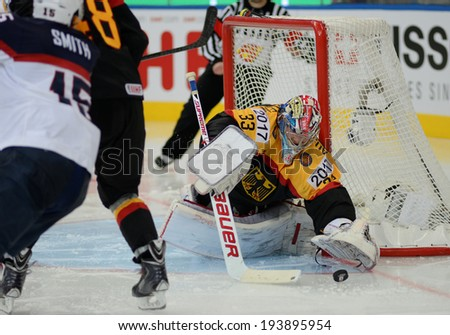 MINSK, BELARUS - MAY 20: AUS den BIRKEN Danny of Germany saves the puck during 2014 IIHF World Ice Hockey Championship match on May 20, 2014 in Minsk, Belarus