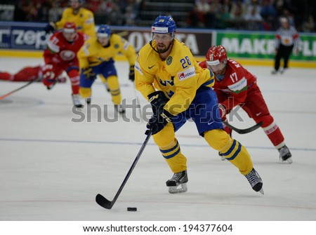 MINSK, BELARUS - MAY 22: AXELSSON Dick of Sweden skates with the puck during 2014 IIHF World Ice Hockey Championship quarterfinal match on May 22, 2014 in Minsk, Belarus.