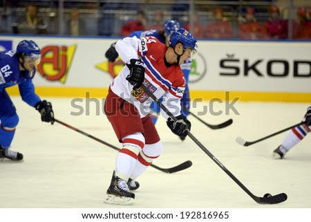 MINSK, BELARUS - MAY 14: Czech Republic\'s Hudler Jiri #24 skates up the ice with puck during preliminary round action at the 2014 IIHF Ice Hockey World Championship on May 14, 2014 in Minsk, Belarus.