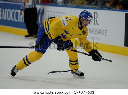MINSK, BELARUS - MAY 22: ERICSSON Jimmie of Sweden shoot the puck during 2014 IIHF World Ice Hockey Championship quarterfinal match on May 22, 2014 in Minsk, Belarus.