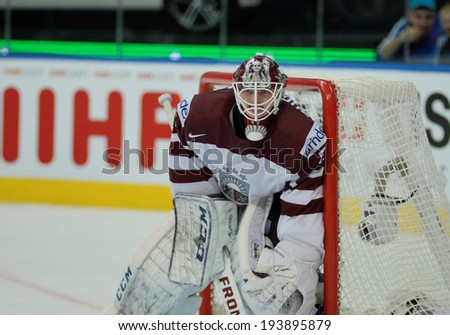 MINSK, BELARUS - MAY 20: GUDLEVSKIS Kristers of Latvia looks on during 2014 IIHF World Ice Hockey Championship match on May 20, 2014 in Minsk, Belarus