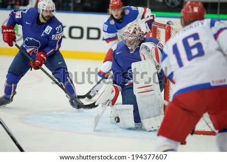 MINSK, BELARUS - MAY 22: HUET Cristobal of France saves the puck during 2014 IIHF World Ice Hockey Championship quarterfinal match on May 22, 2014 in Minsk, Belarus.