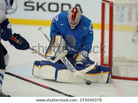 MINSK, BELARUS - MAY 19: IVANOV Alexei (28) of Kazakhstan saves the puck during 2014 IIHF World Ice Hockey Championship match at Minsk Arena on May 19, 2014 in Minsk, Belarus.