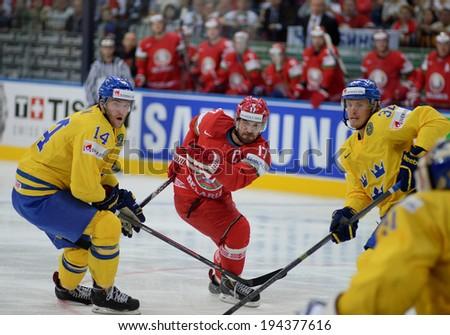 MINSK, BELARUS - MAY 22: KALYUZHNY Alexei of Belarus shoot the puck during 2014 IIHF World Ice Hockey Championship quarterfinal match on May 22, 2014 in Minsk, Belarus.