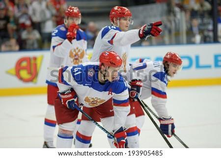 MINSK, BELARUS - MAY 20: KULYOMIN Nikolai of Russia with team during 2014 IIHF World Ice Hockey Championship match on May 20, 2014 in Minsk, Belarus.