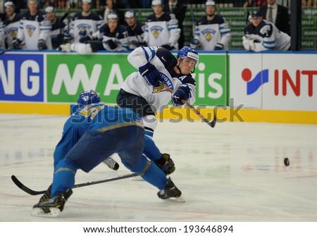MINSK, BELARUS - MAY 19: LEHTERA Jori (21) of Finland shoot the puck during 2014 IIHF World Ice Hockey Championship match at Minsk Arena on May 19, 2014 in Minsk, Belarus.