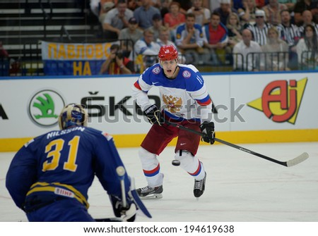 MINSK, BELARUS - MAY 24: MALKIN Yevgeni (11) of Russia shoot the puck during 2014 IIHF World Ice Hockey Championship semifinal match at Minsk Arena on May 24, 2014 in Minsk, Belarus.