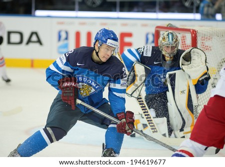 MINSK, BELARUS - MAY 24: MARTTINEN Jyri (28) of Finland skates up the ice during 2014 IIHF World Ice Hockey Championship semifinal match at Minsk Arena on May 24, 2014 in Minsk, Belarus.