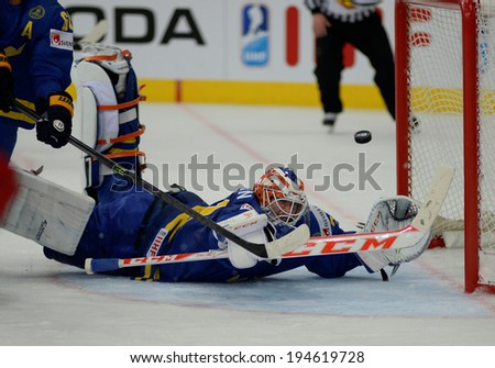 MINSK, BELARUS - MAY 24: NILSSON Anders(31) of Sweden looks on the puck during 2014 IIHF World Ice Hockey Championship semifinal match at Minsk Arena on May 24, 2014 in Minsk, Belarus.