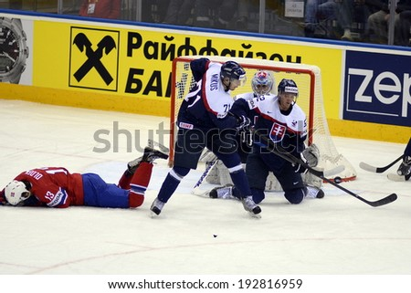 MINSK, BELARUS - MAY 14: Olden Sondre #13 of Norway lyin on ice during  the IIHF World Championship match between Norway and Slovakia at Chizhovka Arena on May 14, 2014 in Minsk, Belarus.