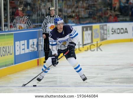 MINSK, BELARUS - MAY 19: PAKARINEN Iiro (81) of Finland shoot the puck during 2014 IIHF World Ice Hockey Championship match at Minsk Arena on May 19, 2014 in Minsk, Belarus.