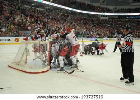 MINSK, BELARUS - MAY 19: Players of Belarus and Latvia fight during 2014 IIHF World Ice Hockey Championship match on May 19, 2014 in Minsk, Belarus.